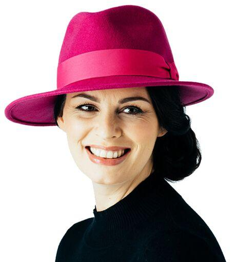 Lady wearing a stylish pink hat
